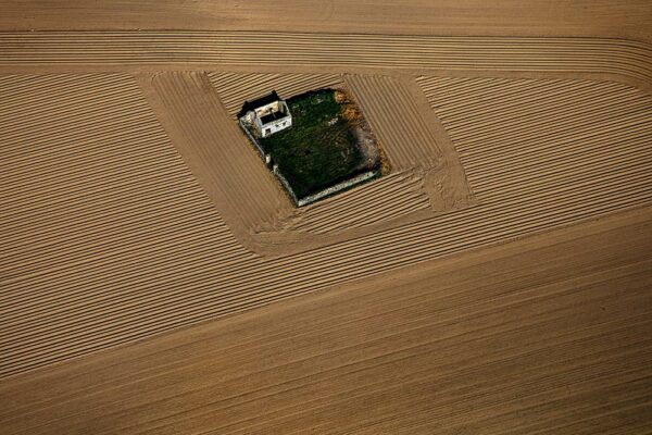 Derelict cottage in a ploughed field